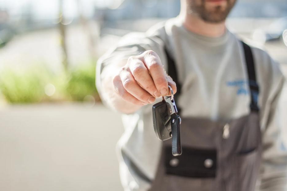 man offering car keys